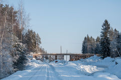 Wooden frame of a bridge. Under construction on a sunny winter day Royalty Free Stock Photography