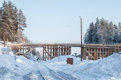 Wooden frame of a bridge. Under construction on a sunny winter day Stock Photography