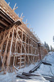 Wooden frame of a bridge. Under construction on a sunny winter day Royalty Free Stock Images