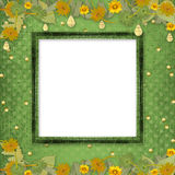 Wooden frame with bunch of flowers and streamers Stock Photos