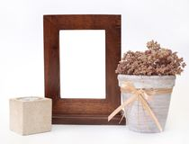 Wooden frame, candlestick and flower pot Stock Photos