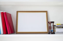 Wooden frame for certificate on the shelf Stock Photography