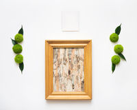 Wooden frame with collage of birch bark and paper. Stock Image