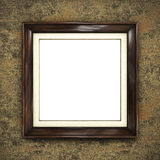 Wooden frame on color wallpaper Stock Images