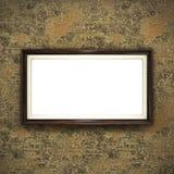 Wooden frame on color wallpaper Stock Image