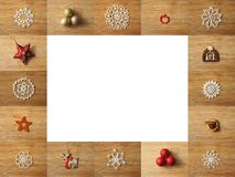 Wooden frame composed of christmas decoration pictures. Space for text inside of the frame royalty free stock photography