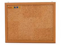 Wooden frame Cork Board with colorful pins. Blank Cork board with wooden frame isolated on white. It has already pins in different colors Royalty Free Stock Photo