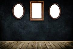 Wooden frame on dark grunge wall. Royalty Free Stock Photos