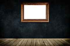 Wooden frame on dark grunge wall. Royalty Free Stock Photography