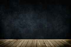 Wooden frame on dark grunge wall. Royalty Free Stock Photo