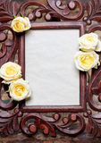 Wooden frame decorated with yellow, pastel roses Royalty Free Stock Image