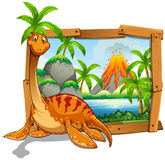 Wooden frame with dinosaur at the lake Stock Photo