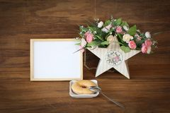 Wooden frame and donut  with romantic flowers Stock Image