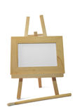 Wooden frame on easel with clipping path. Light wooden frame on easel and brush with clipping path Stock Photos