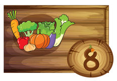 A wooden frame with eight vegetables Royalty Free Stock Photography