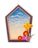 Wooden frame with flower at corner and blue sky space inside Stock Photography