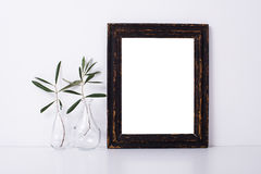 Wooden frame and flowers, home decoration mock-up. On white wall background Stock Photo