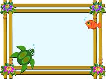 Wooden Frame with Flowers, Turtle, and Fish Stock Photography
