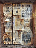A Wooden Frame Full of Wanted Posters Stock Photography