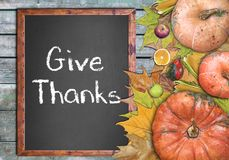 Wooden frame and Give Thanks for thanksgiving day. Close stock images