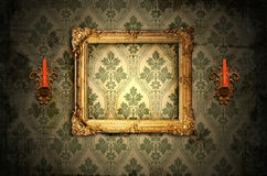 Wooden frame and gold candlesticks Royalty Free Stock Photography