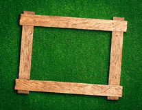 Wooden frame on green royalty free stock images