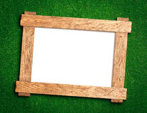Wooden frame on green Stock Photography