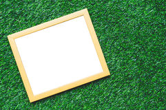 Wooden Frame Green Grass Background. Wooden Frame For Quote On Green Grass Background Royalty Free Stock Photography