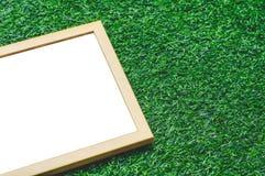 Wooden Frame Green Grass Background. Wooden Frame For Quote On Green Grass Background Stock Photos