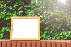 Wooden Frame Green Leaves Background. Wooden Frame For Quote On Green Leaves Background Stock Image