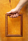 Wooden frame in hand Stock Photos