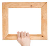 Wooden frame in hand Royalty Free Stock Photography