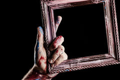 Wooden frame in hand. Art Stock Photography