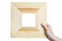 Wooden frame in hand Royalty Free Stock Image