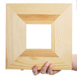 Wooden frame in hand Stock Image