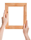 Wooden frame in hands Royalty Free Stock Photography