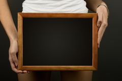 Wooden frame in hands Stock Photos