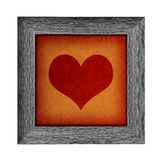 Wooden frame with heart design Stock Photos