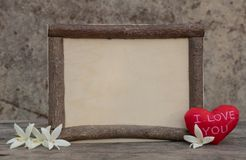 Wooden frame with heart on the wooden table stock images