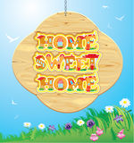 Wooden Frame with Home, sweet home Words on sky ba Royalty Free Stock Photo