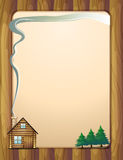 A wooden frame with a house and trees Royalty Free Stock Image