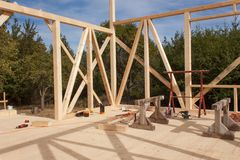 Wooden frame of house under construction.Framed New Construction of a House. Timber house in building process Stock Image