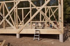Wooden frame of house under construction.Framed New Construction of a House. Timber house in building process Royalty Free Stock Photography