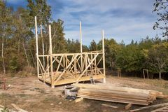 Wooden frame of house under construction.Framed New Construction of a House. Timber house in building process Stock Photography