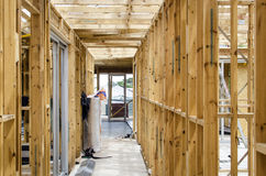 Wooden frame of a house under construction. Inside wooden frame of a house under construction royalty free stock images