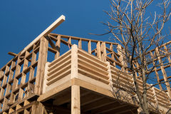 Wooden frame of house under construction. Wooden frame of a new house under construction royalty free stock image