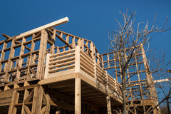 Wooden frame of house under construction. Wooden frame of a new house under construction stock image