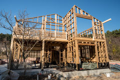 Wooden frame of house under construction. Wooden frame of a new house under construction stock photo