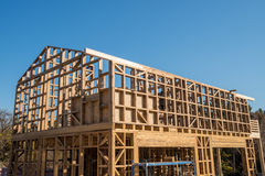 Wooden frame of house under construction. Wooden frame of a new house under construction royalty free stock photography