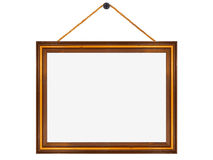 Wooden frame hung from a nail Royalty Free Stock Image